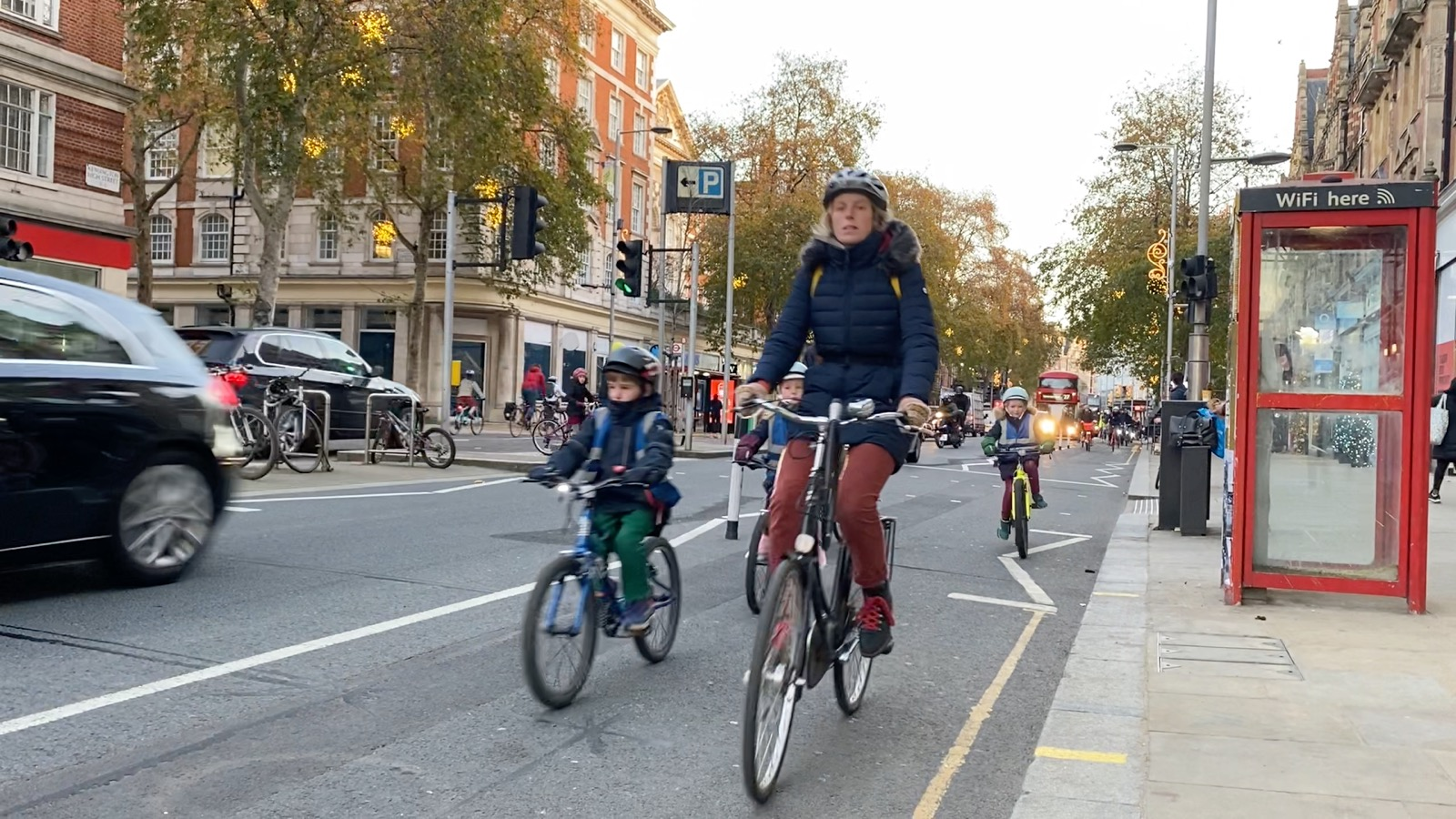 Mum and Son cycling on High Street Kensington